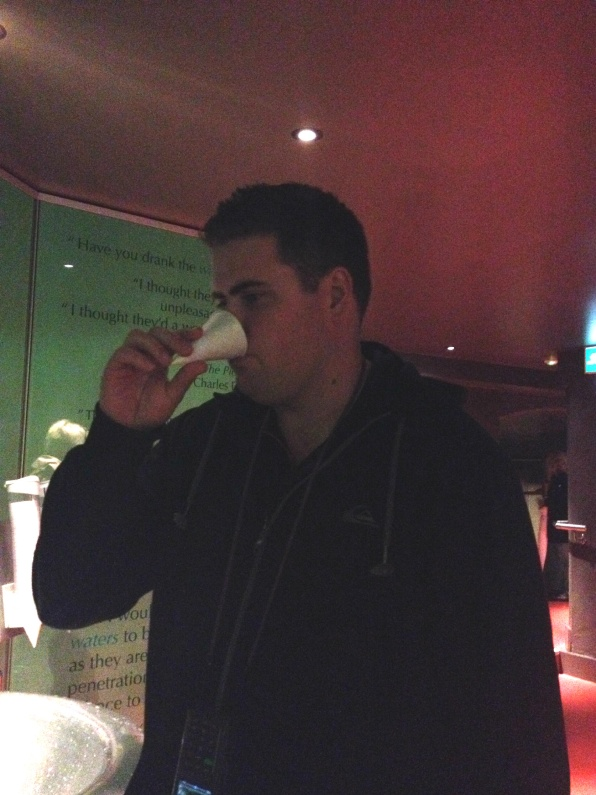 shaun drinking the water from the roman baths
